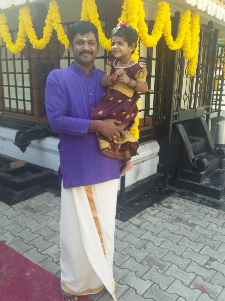Picture of Rithika with her father. Image Credit: Dhanya Vallat